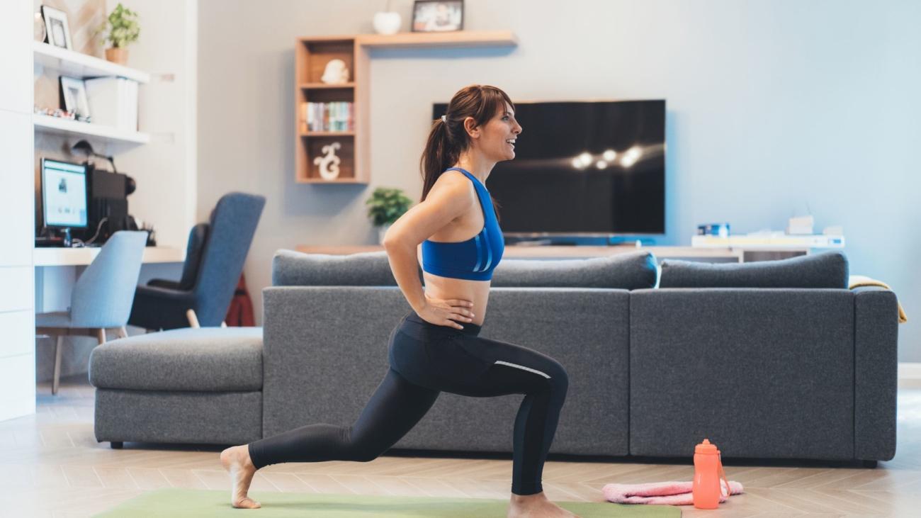 woman-exercising-at-home-royalty-free-image